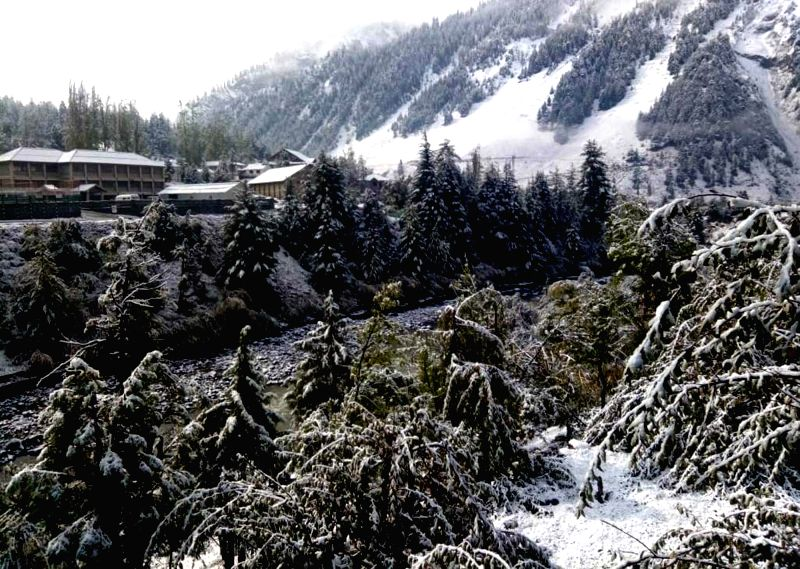 A view of snow-covered Udaipur village near Keylong after fresh snowfall in Lahaul and Spiti district of Himachal Pradesh on Oct 11, 2018(Image Source: IANS)