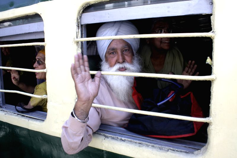 An Indian Sikh pilgrim arrives at Wagah Railway Station in eastern Pakistan's Lahore on April 10, 2014, to celebrate Baisakhi, or the Sikh New Year. Sikh pilgrims ..