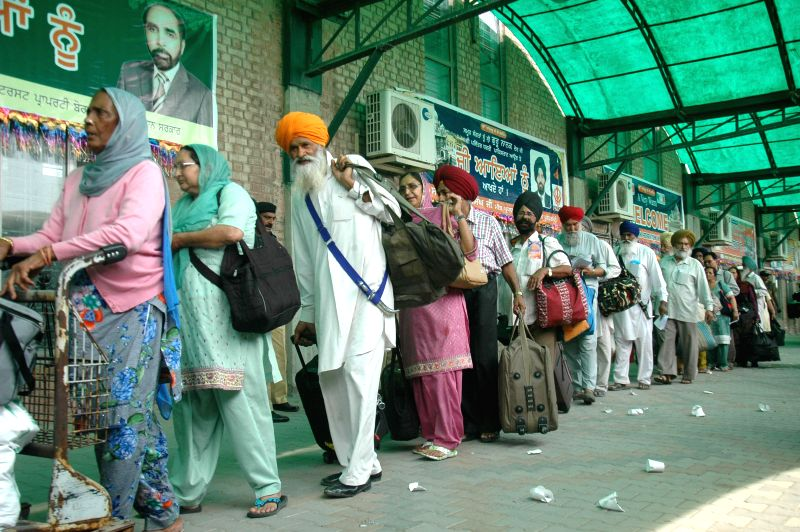 Indian Sikh pilgrims arrive at Wagah Railway Station in eastern Pakistan's Lahore on April 11, 2015. The first batch of Sikh pilgrims arrived in Pakistan from India ...