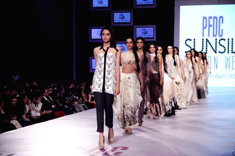 Models present creations by designer Nida Azwer on the third day of the PFDC Sunsilk Fashion Week in eastern Pakistan's Lahore on April 12, 2014. ...
