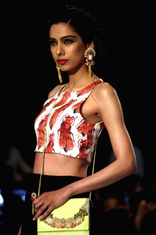 A model presents a creation by designer Zara Shahjahan on the last day of PFDC Sunsilk Fashion Week in eastern Pakistan's Lahore on April 13, 2014. (Xinhua/Jamil ...