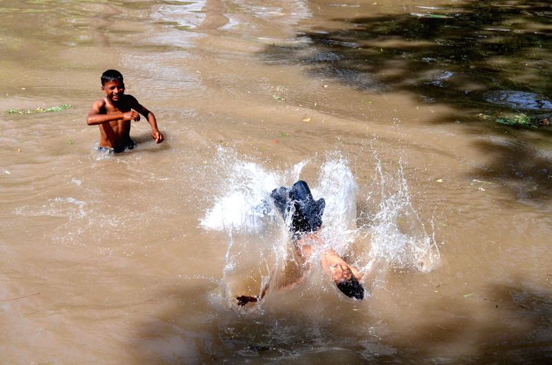 LAHORE, April 17, 2017 - Pakistani children take bath in a canal to cool themselves off during heat wave in eastern Pakistan's Lahore, on April 17, 2017. The temperature reached 43 degrees centigrade ...