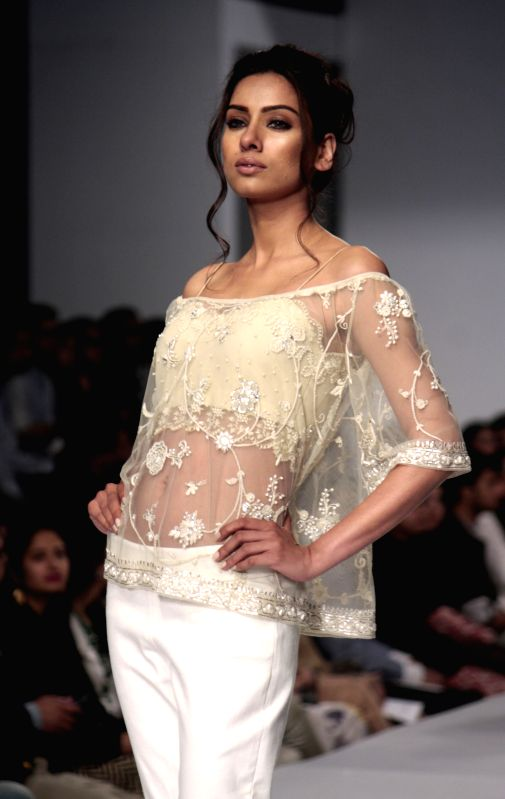 A model presents a creation by designer Zonia Anwar at the Pakistan Fashion Design Council (PFDC) Sunsilk Fashion Week in eastern Pakistan's Lahore on April 18, ...