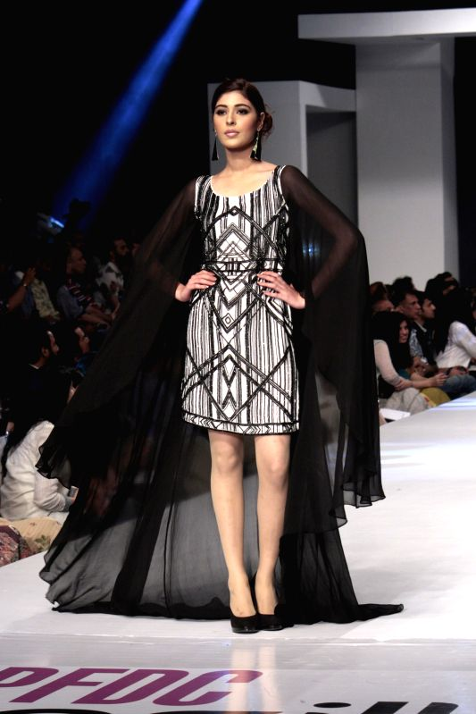 A model presents a creation by designer Nicke and Nina at the Pakistan Fashion Design Council (PFDC) Sunsilk Fashion Week in eastern Pakistan's Lahore on April 18, ...