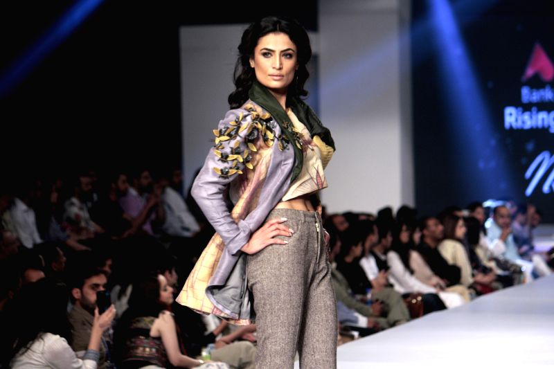 A model presents a creation by designer Misha Lakhani at the Pakistan Fashion Design Council (PFDC) Sunsilk Fashion Week in eastern Pakistan's Lahore, April 18, ...