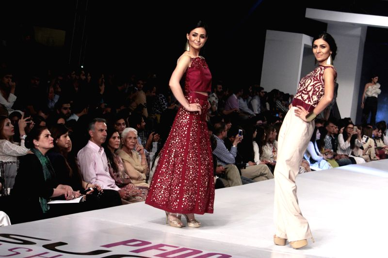 Models present creations by designer Nicke and Nina at the Pakistan Fashion Design Council (PFDC) Sunsilk Fashion Week in eastern Pakistan's Lahore on April 18, ...