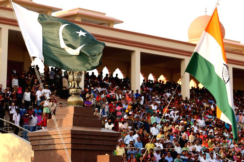 LAHORE, April 26, 2017 - A Pakistani national flag (L) and an Indian national flag are seen during a flag lowering ceremony at Wagah border between Pakistan and India in eastern Pakistan's Lahore, ...