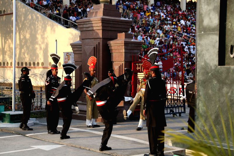LAHORE, April 26, 2017 - Pakistani soldiers (in black) and Indian soldiers (in brown) perform during a flag lowering ceremony at Wagah border between Pakistan and India in eastern Pakistan's Lahore, ...