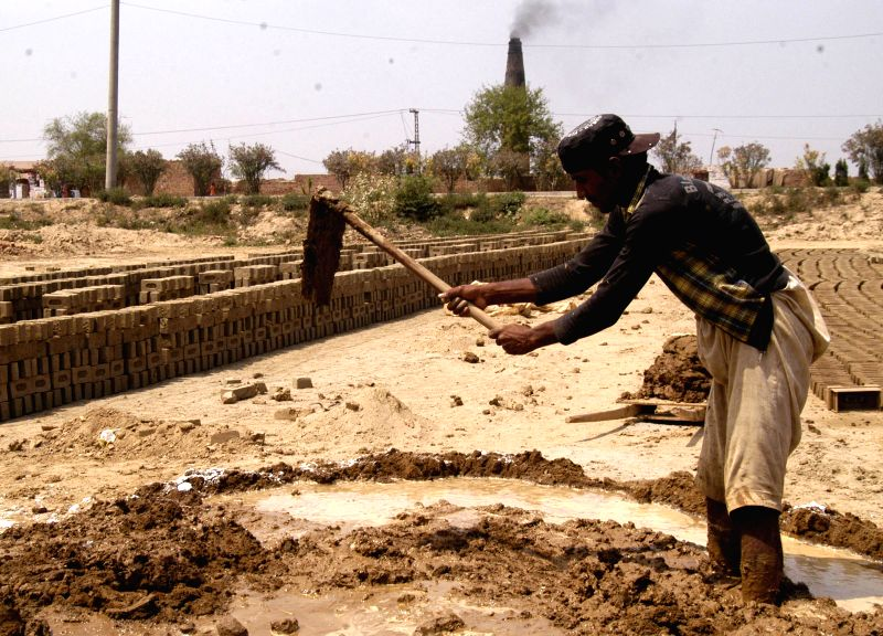 A Pakistani laborer works at a brick factory on the eve of International Labor Day in eastern Pakistan's Lahore on April 30, 2014. Pakistan has a workforce of ...