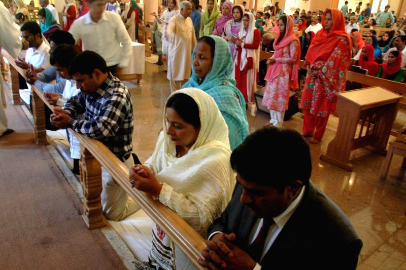 Pakistani Christians attend an Easter Mass at a Church in eastern Pakistan's Lahore, April 5, 2015. Christians around the world attend Easter service in celebration ...