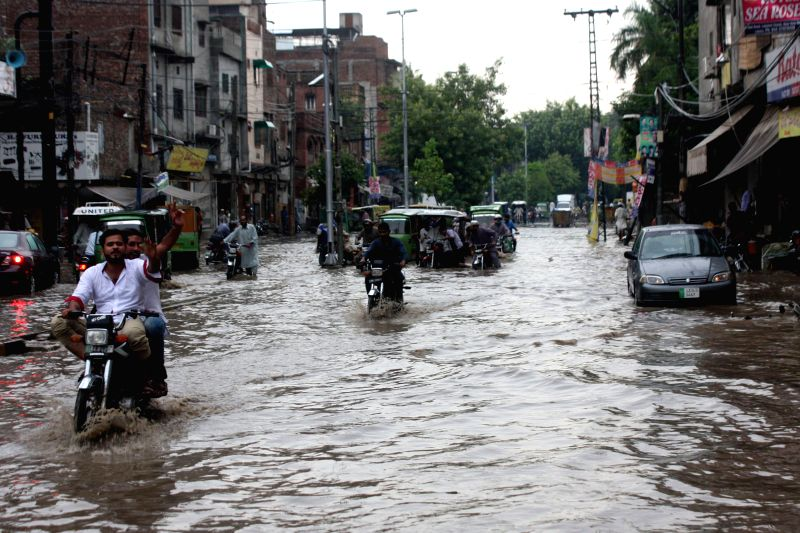 LAHORE, Aug. 10, 2016 - Vehicles run in flooded water after heavy monsoon rain in eastern Pakistan's Lahore, Aug. 10, 2016.