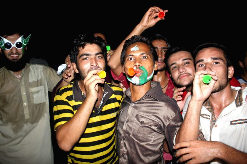 Pakistani youth celebrate the Independence Day of Pakistan in eastern Pakistan's Lahore, Aug. 14, 2014. Pakistan got independence from the British colonial rule on ..