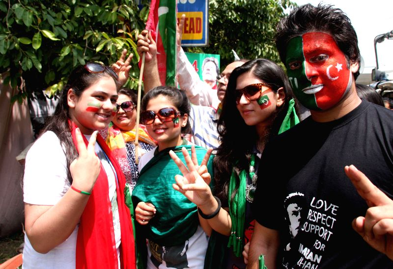 Supporters of Pakistan senior opposition leader Imran Khan gather as he heads a protest march from Lahore to Islamabad against the government, in east Pakistan's ... - Imran Khan