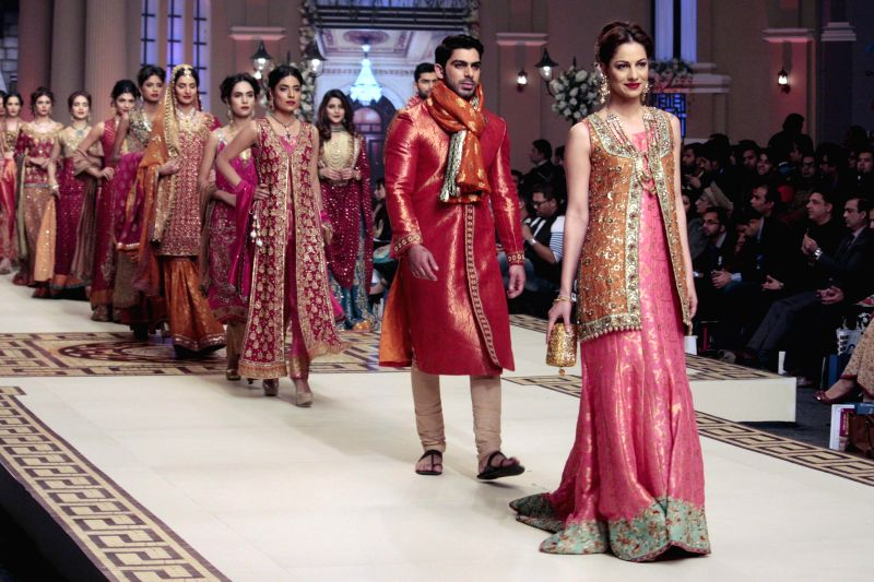 Models present creations designed by Umsha on the second day of Bridal Couture Fashion Week in eastern Pakistan's Lahore on Dec. 12, 2014.