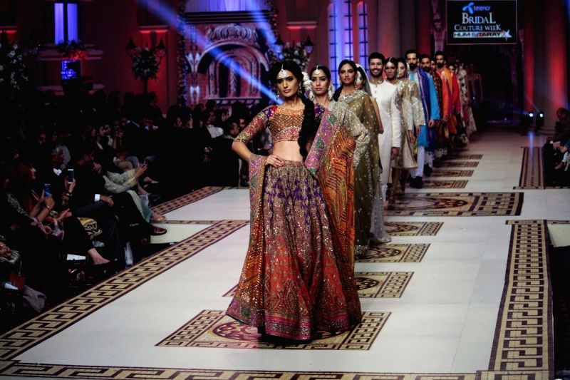 Models present creations designed by Umar Saeed on the last day of Bridal Couture Fashion Week in eastern Pakistan's Lahore, Dec. 13, 2014.