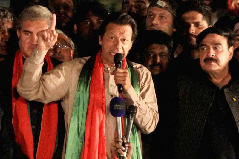 Pakistani cricketer-turned-politician Imran Khan (C) addresses his supporters during an anti-government protest in eastern Pakistan's Lahore on Dec. 15, 2014. Senior - Imran Khan