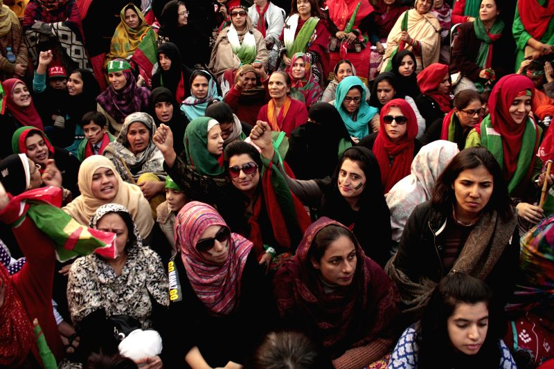 Supporters of Imran Khan's Pakistan Tehreek-e-Insaaf (PTI) gather during an anti-government protest in eastern Pakistan's Lahore on Dec. 15, 2014. Senior Pakistani .. - Imran Khan