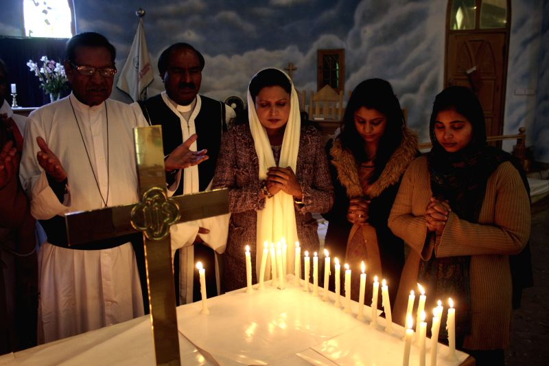 Pakistani Christians pray for the victims of the army-run school attack at Central Cathedral Church in east Pakistan's Lahore on Dec. 20, 2014. At least 141 people, .