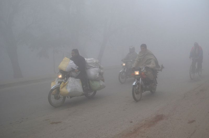 Vehicles move during heavy fog in eastern Pakistan's Lahore on Feb. 1, 2015. Heavy fog surrounds Lahore with zero visibility.