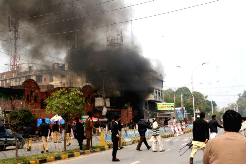 Smoke rises from the blast site in eastern Pakistan's Lahore, Feb. 17, 2015. At least eight persons were killed and 12 others injured on Tuesday afternoon in a ...