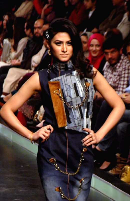 A model presents a creation designed by Hassan Shehriyar on the last day of Lahore Fashion Week in eastern Pakistan's Lahore on Feb. 21, 2015.