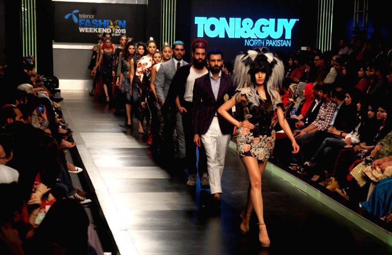 Models present creations designed by Hassan Shehriyar on the last day of Lahore Fashion Week in eastern Pakistan's Lahore on Feb. 21, 2015.