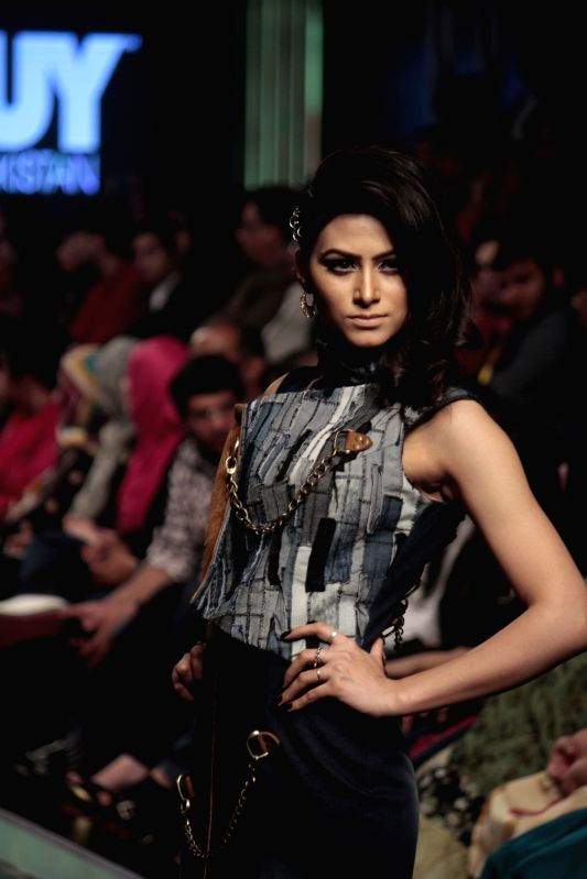 A model presents a creation of Toni and Guy on the last day of Lahore Fashion Week in east Pakistan's Lahore, Feb. 21, 2015.
