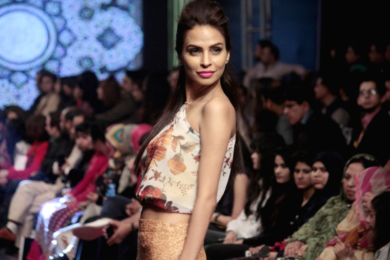 A model presents a creation by designer Pareesa on the last day of Lahore Fashion Week in east Pakistan's Lahore, Feb. 21, 2015.