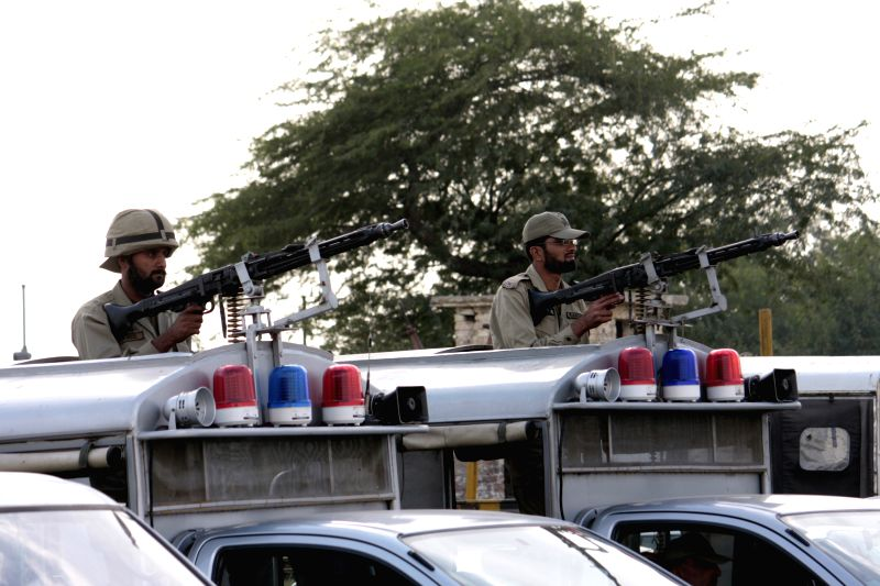 Pakistani soldiers guard in eastern Pakistan's Lahore, Feb. 24, 2015, due to possible terrorist attacks.