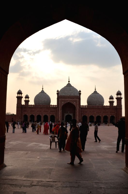 "Tourists visit the Badshahi Mosque in eastern Pakistan's Lahore on Feb. 27, 2015. The Badshahi Mosque, or the ""Imperial Mosque"", which was commissioned by ..."