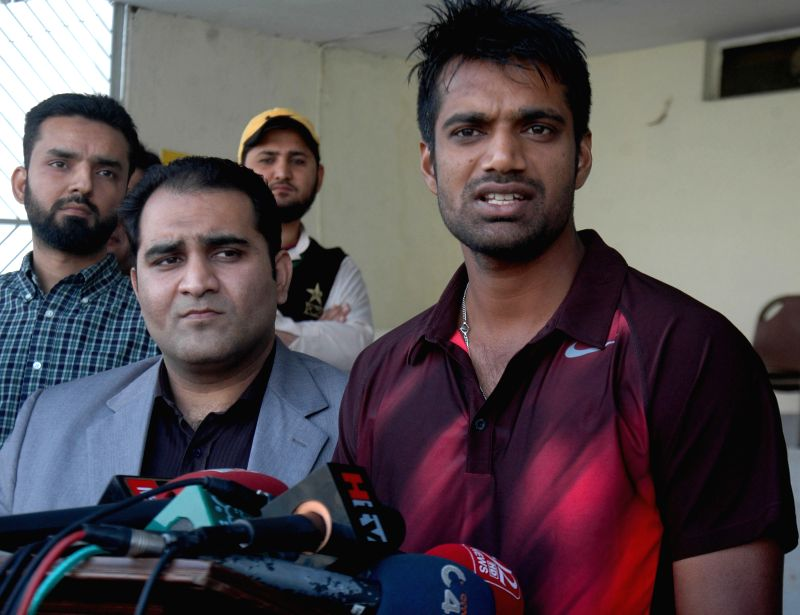 Pakistan cricketer Rahat Ali (R) speaks during a press conference in eastern Pakistan's Lahore, Feb. 9, 2015. Ali and Jamshed left for Australia later on Monday to ... - Junaid Khan