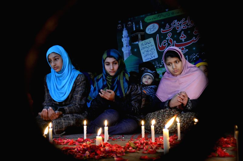 Pakistani women pray to celebrate the New Year in Lahore, Pakistan, Jan. 1, 2015.