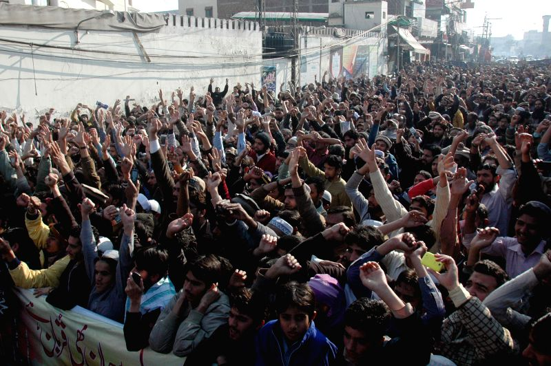 Pakistani people shout slogans against the printing of satirical sketches of the Prophet Mohamed by French magazine Charlie Hebdo during a protest in eastern ...
