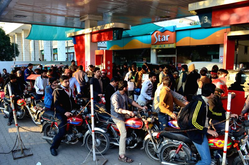 Pakistani motorists queue at a petrol station in eastern Pakistan's Lahore on Jan. 17, 2015.  Delayed oil consignments have left large areas of the country facing ...