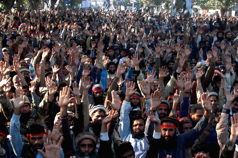 Supporters of Pakistani Jamaat-ud-Dawa group shout slogans during a protest against the printing of satirical sketches of the Prophet Mohammad by French magazine ...