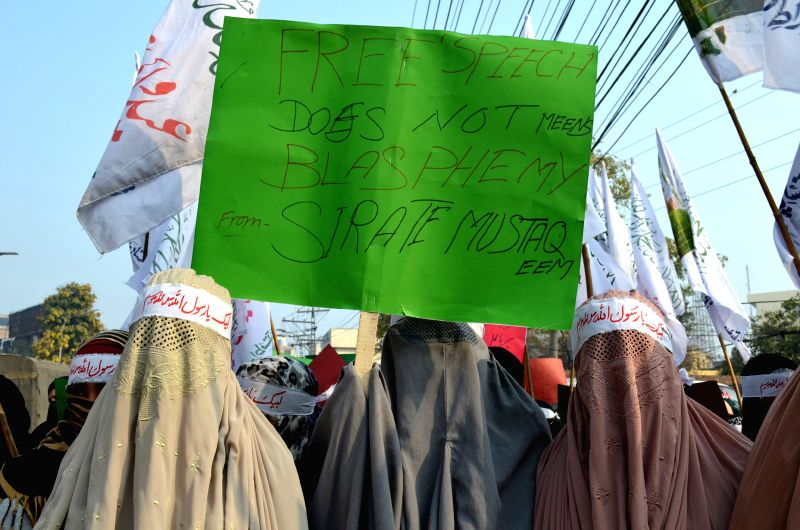 Pakistan women participate in a protest against the printing of caricature of Prophet Muhammad  by French magazine Charlie Hebdo, in eastern Pakistan's Lahore on ...