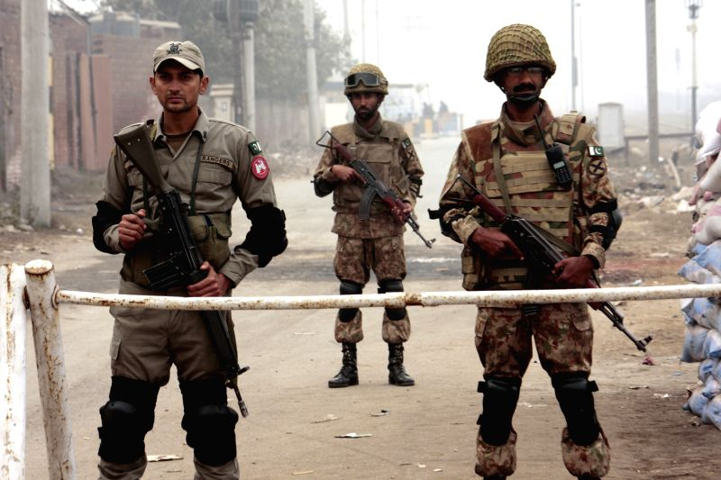 Pakistani soldiers stand guard outside the Kot Lakhpat Central jail in eastern Pakistan's Lahore, Jan. 8, 2015. Security upgraded to high alert after the lifting of a