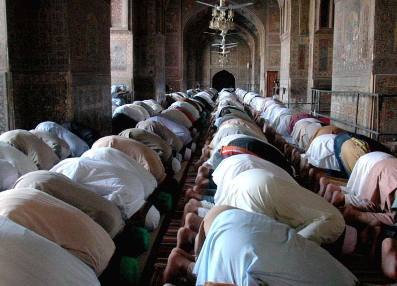 Pakistani Muslims offer special Friday prayer at a mosque during holy month of Ramadan in eastern Pakistan's Lahore on July 11, 2014.