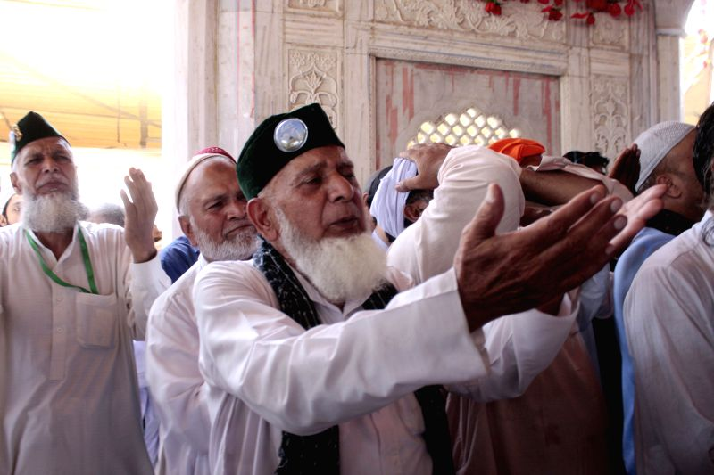 Muslims pray at Data Darbar shrine during Muslims holy month of Ramadan in eastern Pakistan's Lahore, July 12, 2014.  ****Authorized by ...