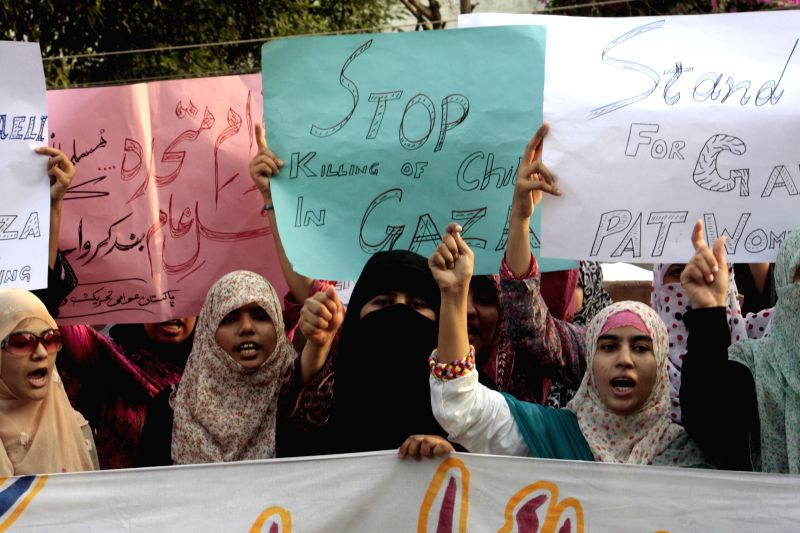 Pakistani protesters shout slogans during a demonstration against Israeli military operations in Gaza, in eastern Pakistan's Lahore on July 14, 2014. Protests across