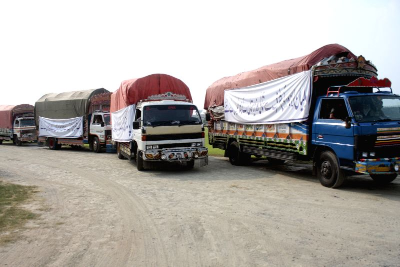 Trucks carrying relief supplies for internally displaced Pakistani civilians fleeing a military operation against militants in North Waziristan, are dispatched to ...