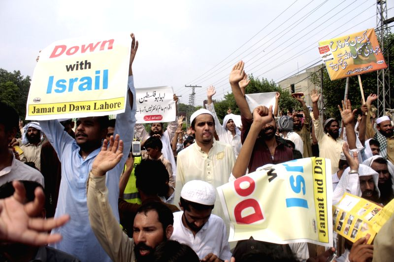 Pakistani supporters of Jamat-ud-Dawa (JuD) shout slogans during a protest rally against Israeli military strikes on the Gaza Strip, in eastern Pakistan's Lahore on . - Nawaz Sharif