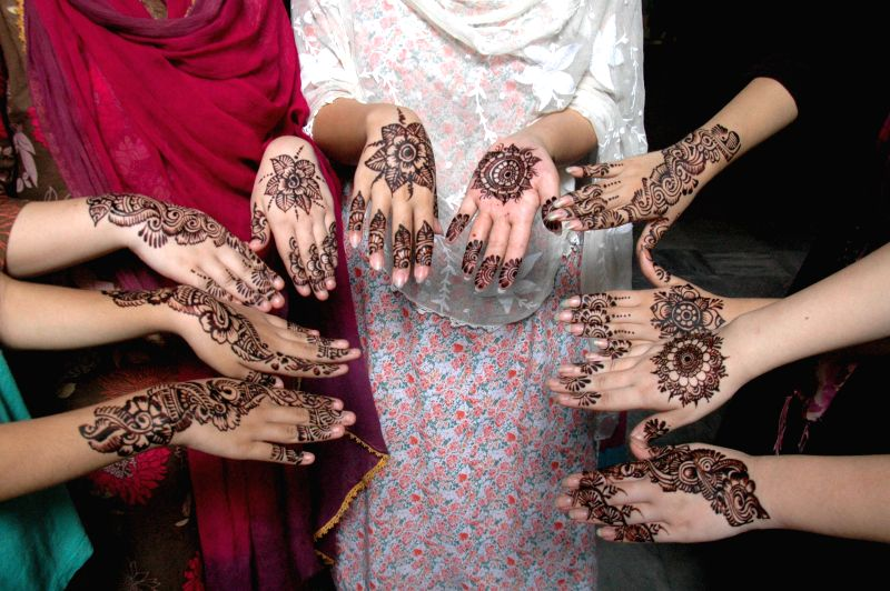 Pakistani girls show their hands painted with henna on the eve of the Muslim festival Eid al-Fitr in eastern Pakistan's Lahore on July 28, 2014.