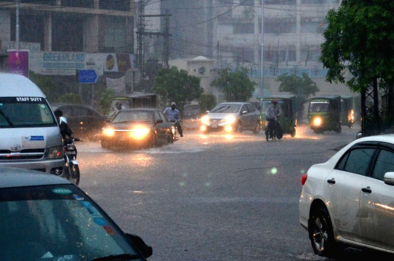 LAHORE, July 29, 2016 - Vehicles move on a road during heavy rain in eastern Pakistan's Lahore, July 29, 2016. Pakistan's Met office has predicted heavy rains in different parts of the country for ...