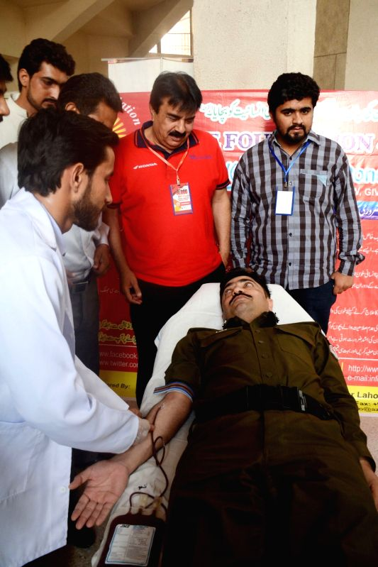 LAHORE, June 14, 2017 - A man donates blood on the World Blood Donor Day in eastern Pakistan's Lahore, on June 14, 2017. World Blood Donor Day is annually commemorated on June 14, with the purpose of ...