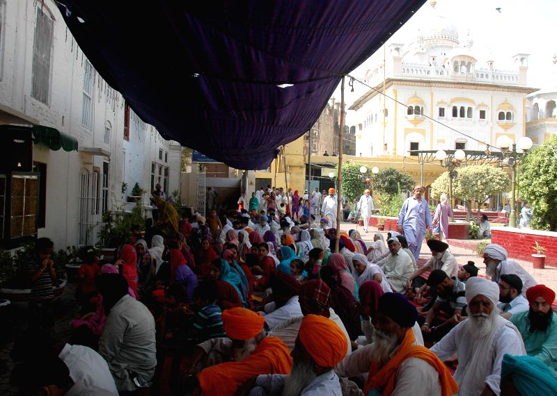 Indian Sikh devotees pray at the Gurdwara Dhara Sahib in Lahore, east Pakistan, June 16, 2014.