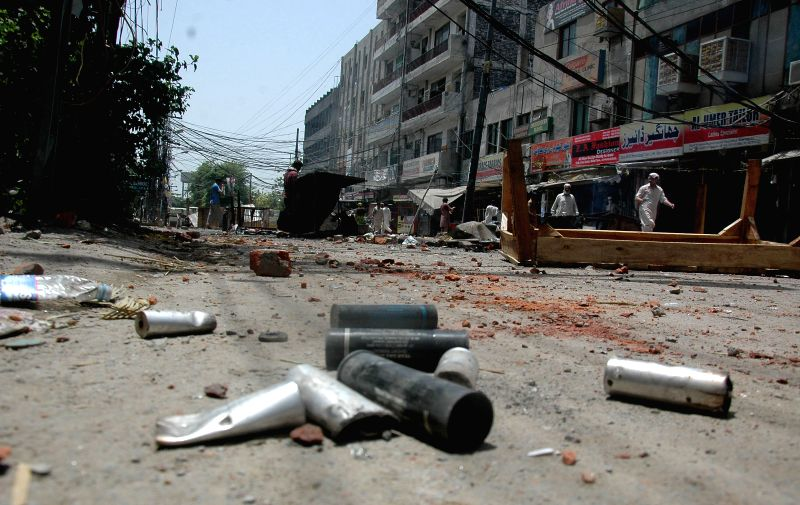 Empty teargas shells are seen on road during clashes between Pakistan Awami Tehreek (PAT) protestors and police in east Pakistan's Lahore on June 17, 2014. At least .