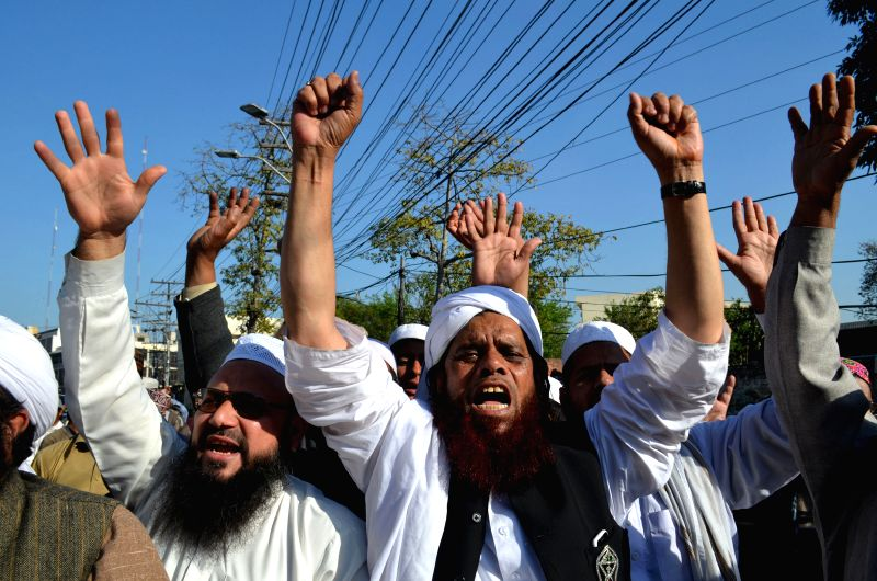 Activists shout slogans during a demonstration against the sentence of a former police commando who killed Punjab's governor, in eastern Pakistan's Lahore, March ...