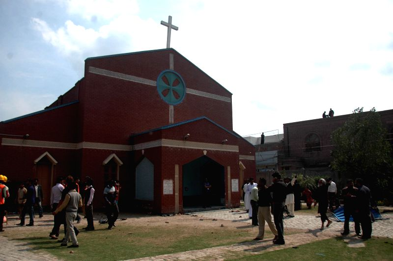 Pakistani Christians gather outside a church following suicide bombing attacks in eastern Pakistan's Lahore on March 15, 2015. At least 14 people were killed and 78 ...