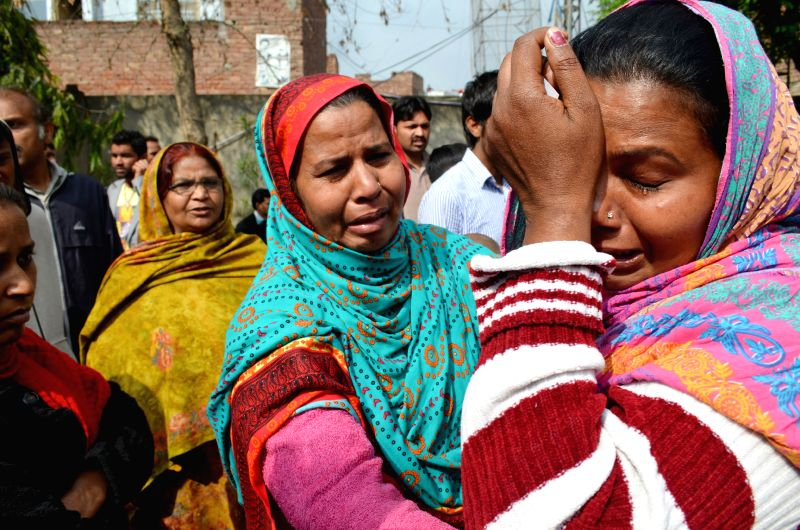 Pakistani Christians mourn during special prayers in eastern Pakistan's Lahore on March 16, 2015, in a protest against suicide bombing attacks on churches by ...
